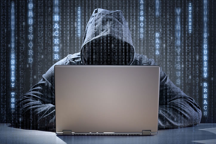 Person on the computer using provisioning solutions to help protect against CPE fraud